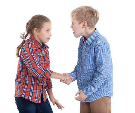 Brother and sister with severe looks shaking hands, isolated white background