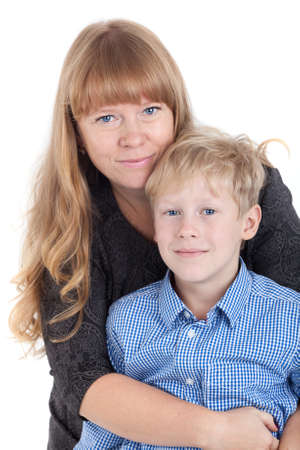 two women hugging: Smiling happy Caucasian mother hugging her son, portrait isolated on white background