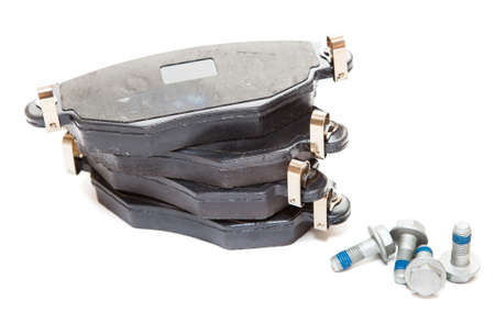 aftermarket: Two pairs of new brake pads with screws isolated on white background Stock Photo