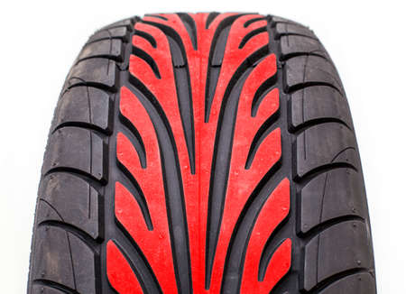 tread pattern: Wet weather tire with red color tread in the middle of contact area pattern, isolated on white background Stock Photo