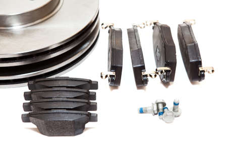 aftermarket: New brake pads and discks isolated on white background Stock Photo