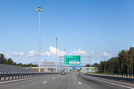 autotruck: Wide multilane Ring Road with direction signs at summer season, highway around the city, St. Petersburg, Russia Stock Photo