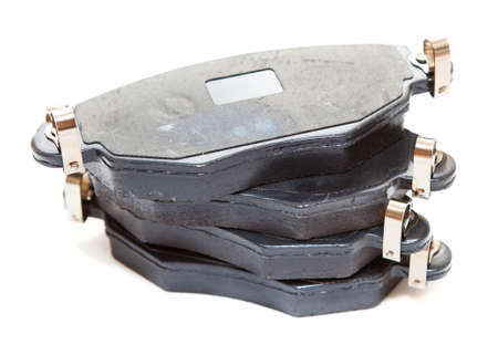 aftermarket: Set of four new brake pads for car, isolated on white background