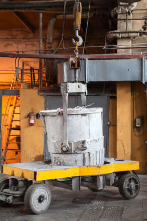 aluminum: Bucket with molten aluminum stands on trolley to transport it to forming machine, an aluminum plant
