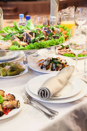 formal dinner: Formal dinner service as at a wedding, banquet or a party