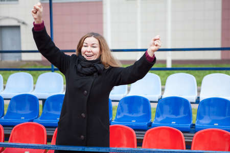 Russian Caucasian woman fan screaming and gesturing on the national flag seats