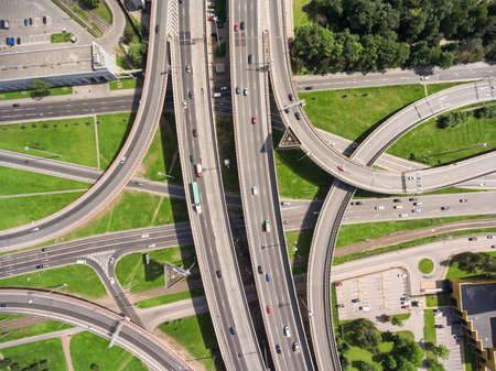 junctions: Aerial view at junctions of city highway. Vehicles drive on roads. Russia Stock Photo