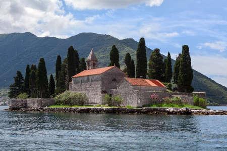 kotor: Natural islet the Sveti Dorde with Saint George Benedictine monastery. It is near the Gospa od Skrpjela island, coast of Perast in Kotor Bay. Montenegro