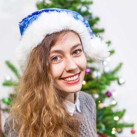 Young woman presented to a stack of money at the Christmas eve Stock Photo