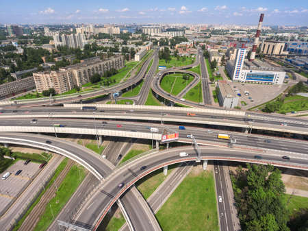ST. PETERSBURG, RUSSIA, CIRCA MAY, 2016: Aerial view at junctions of city highway in Nevsky district. Vehicles drive on roads
