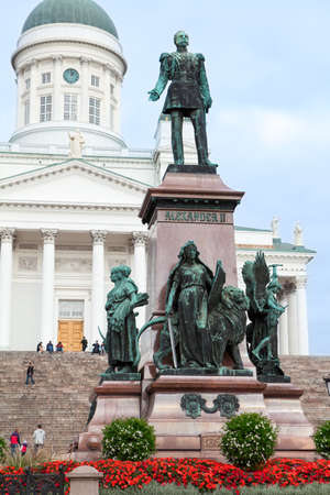 aleksander: HELSINKI, FINLAND - CIRCA SEP, 2016: Statue of Emperor Alexander II is on the center of Senate Square on the background of Saint Nicholas Cathedral. Attractions of Helsinki