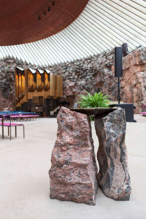 HELSINKI, FINLAND - CIRCA SEP, 2016: Stands for flowers are made from natural stone. Interior of the Temppeliaukio Lutheran Church. The temple is carved into the rock Editorial