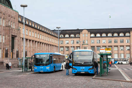 railway transport: HELSINKI, FINLAND - CIRCA SEP, 2016: Blue buses are on public transport terminus at the railway and metro station. Rautatientori is the local point of all urban public transport in the Kluuvi Editorial