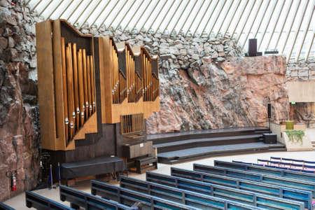 HELSINKI, FINLAND - CIRCA SEP, 2016: Lutheran Church Temppeliaukio is in Toolo, Helsinki suburbs. The church organ is near a rock wall. Interior, view from the balcony