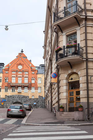 HELSINKI, FINLAND - CIRCA SEP, 2016: Building of Old Physiology University is on the background of the historic dwelling houses in center. Helsinki is the capital and largest city of Finland.