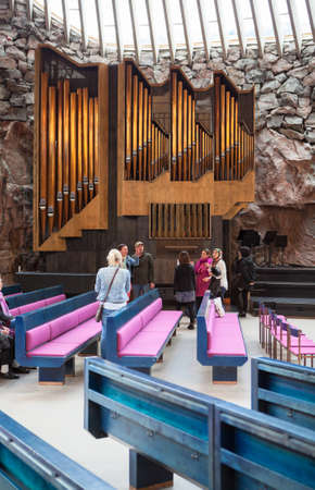 HELSINKI, FINLAND - CIRCA SEP, 2016: Visitors are in the hall of church near large pipe organ. The Temppeliaukio Lutheran Church. The temple is carved into the rock Editorial
