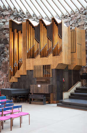HELSINKI, FINLAND - CIRCA SEP, 2016: Large pipe organ is in interior of Temppeliaukio. The Temppeliaukio Lutheran Church. The temple is carved into the rock