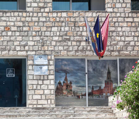 consulate: BUDVA, MONTENEGRO - CIRCA JUN, 2016: Information plates and flags of honorary Consulate of the Russian Federation are on the facade of the Avala Resort & Villas in city of Budva.