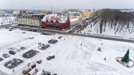 VYBORG, RUSSIA - CIRCA JAN, 2017: The Market square is in city center at winter season. Aerial view. Vyborg is old town in Leningrad Oblast.