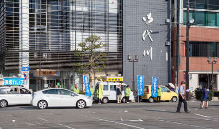 people in action: KAMAKURA, JAPAN - CIRCA APR, 2013: Japanese people make advertising action on street of city in center. Kamakura is a coastal city in Kanagawa Prefecture