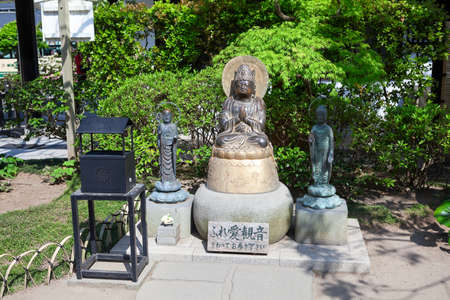 KAMAKURA, JAPAN - CIRCA APR, 2013: Statues of praying Buddhas are in Jizo-do hall in the Hasedera shrine. The Hase-kannon (Hase-dera) is one of the Buddhist temples in the Kanagawa Prefecture