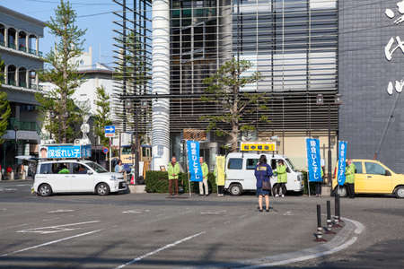 kanagawa: KAMAKURA, JAPAN - CIRCA APR, 2013: Sales advertising action is on street of city in center. Kamakura is a coastal city in Kanagawa Prefecture
