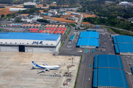 NARITA, JAPAN - CIRCA APR, 2013: Aerial view at the hangars and runway of the Narita International Airport. Narita Airport is the predominant airport. It is in Chiba Prefecture