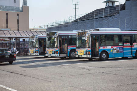 sideway: KAMAKURA, JAPAN - CIRCA APR, 2013: Passenger buses wait on main station in Kamakura city in Kanagawa Prefecture. The bus service operator is the Enoshima Electric Railway or Enoden Editorial