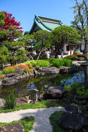 KAMAKURA, JAPAN - CIRCA APR, 2013: Beauty garden with pond is in the Hasedera shrine. The Hase-kannon (Hase-dera) is one of the Buddhist temples in the Kanagawa Prefecture