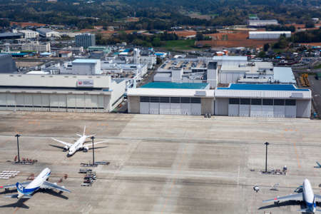 NARITA, JAPAN - CIRCA APR, 2013: Top view at runway with aircrafts of the Narita International Airport. Narita Airport is the predominant airport. It is in Chiba Prefecture
