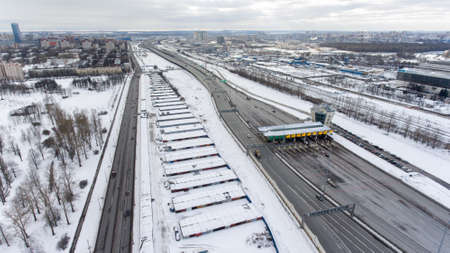 turnpike: Carriageway and toll collection area are on the Western High Speed ??Diameter (WHSD) highway, Saint-Petersburg. Top view at winter season Stock Photo