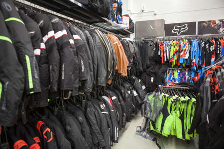 motor bike: LAPPEENRANTA, FINLAND - CIRCA FEB, 2017: A racks with protective leather jackets for riding are in motorcycle shop. The Motonet is a large chain retailer goods for activity and sports in Finland