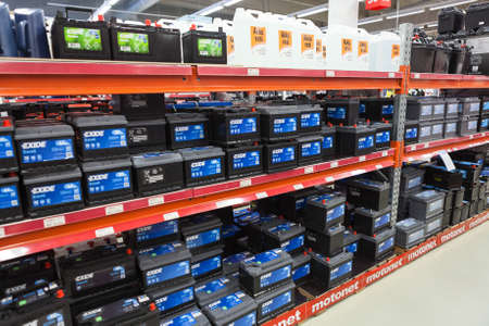 car retailer: LAPPEENRANTA, FINLAND - CIRCA FEB, 2017: A lot of new batteries for vehicles are on the racks of car accessories shop. The Motonet is a large chain retailer of auto and motorgoods in Finland