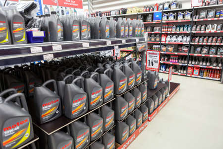 car retailer: LAPPEENRANTA, FINLAND - CIRCA FEB, 2016: Offers with car engine oils are in auto parts store. The Motonet is a large chain retailer of auto and motorcycle goods in Finland Editorial