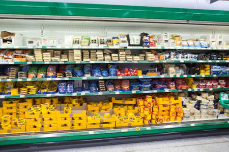 LAPPEENRANTA, FINLAND - CIRCA FEB, 2016: Trading refrigerator stalls with different types of cheese are in Prisma hypermarket. Prisma is Finnish family-friendly hypermarket of the cooperative S Group