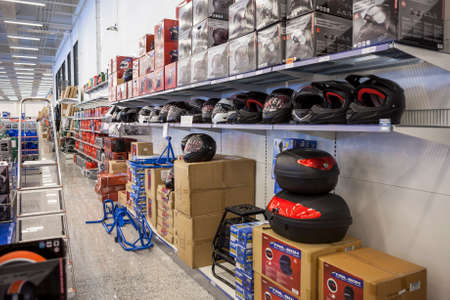 aftermarket: LAPPEENRANTA, FINLAND - CIRCA FEB, 2016: Motorcycle accessories are in large salesroom of wholesale hypermarket. Biltema is is a Swedish chain of retail stores in Nordic countries
