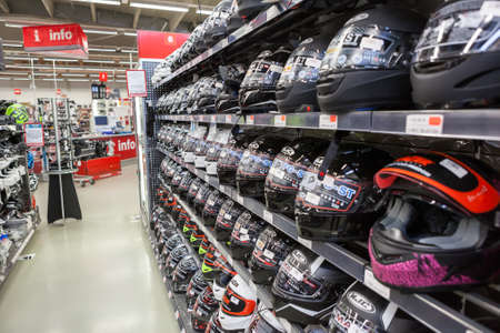 LAPPEENRANTA, FINLAND - CIRCA FEB, 2017: A lot of integral helmets for motorcycle ride is in shop. The Motonet is a large chain retailer of auto and motorcycle goods in Finland