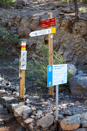information point: Information road signs are on the intermediate point of hiking trail with direction to La Esperanza and Lunar landscape. Tenerife, Canary island, Spain Editorial