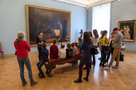ST. PETERSBURG, RUSSIA - CIRCA APR, 2017: Woman a guide tells children about the picture The Last Supper by Nikolai Ge. Russian State Museum, the Mikhailovsky Palace