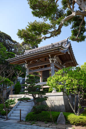KAMAKURA, JAPAN — CIRCA APR, 2013: Wooden bell tower is in inner yard of Hasedera Shrine. Temple is near the village of Hase in the Nara region Editorial