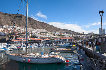 dampen: LOS GIGANTES, TENERIFE, SPAIN - CIRCA JAN, 2016: port is surrounded by concrete walls to dampen the effect of the rough seas around the area. Los Gigantes is a resort town on the west coast Editorial