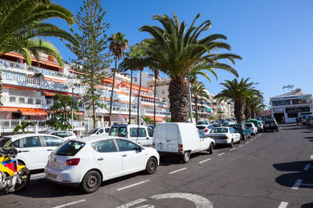 LOS CRISTIANOS, TENERIFE, SPAIN - CIRCA JAN, 2016: Parallel parking areas are in street of resort city. Full parking lots are in city at summer season Editorial