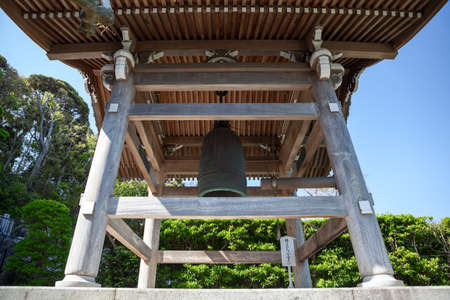 KAMAKURA, JAPAN — CIRCA APR, 2013: Wooden bell-tower with large bell is in inner courtyard of Hasedera Shrine. Temple is near the village of Hase in the Kanagawa prefecture Editorial