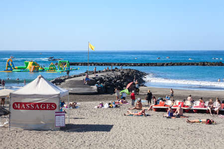 COSTA ADEJE, TENERIFE, CANARY, SPAIN-CIRCA JAN, 2016: Tent for massage and spa is on sandy beach the Torviscas. Torviscas and Fanabe are city resorts with grey sand Editorial