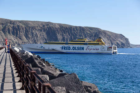 LOS CRISTIANOS, TENERIFE, CANARY, SPAIN - CIRCA JAN, 2016: The Fred Olsen Express ferry boat enters port. Maritime links connects the seven islands of the Canary archipelago