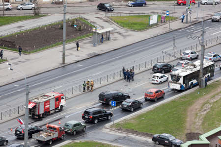 exceeding: ST.PETERSBURG, RUSSIA-CIRCA MAY, 2017: Firefighters are near crashed cars on city street. Crash between several vehicles due the high speed exceeding. No one was injured. Editorial