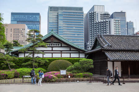 ancient near east: TOKYO, JAPAN - CIRCA APR, 2013: Visitors walk near ancient building of the Hyakunin-bansho Guardhouse. The biggest guardhouse is near the Ote-mon Gate. The East Garden of the Imperial Palace in Tokyo