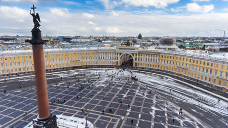 The General Staff Building, long bow-shaped facade separated by a tripartite triumphal arch with chariot with horses and Aleksandr Column. Winter season. St. Petersburg, Russia. Aerial view