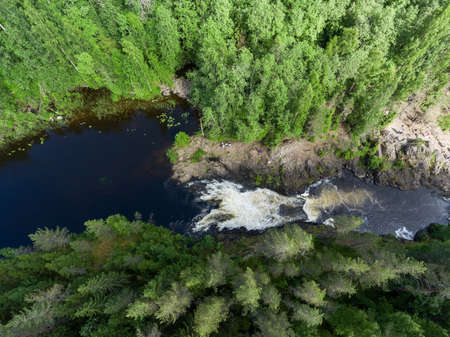 The riverbed of the Suna river and the Kivach waterfall. View from above. Karelia, Russia