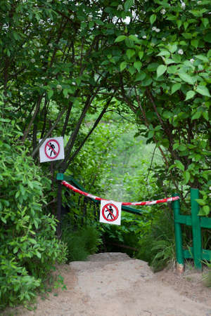 no entrance: Signs with signs passage forbidden, descent the stairs down among the bushes